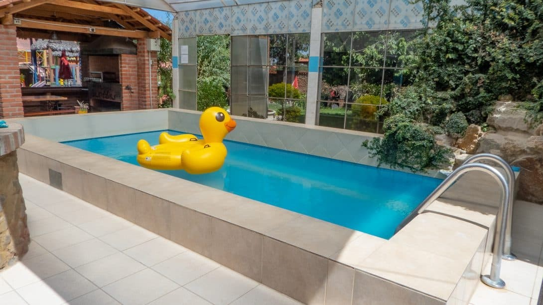 Pool with duck inflatable at Cabañas Las Lilas