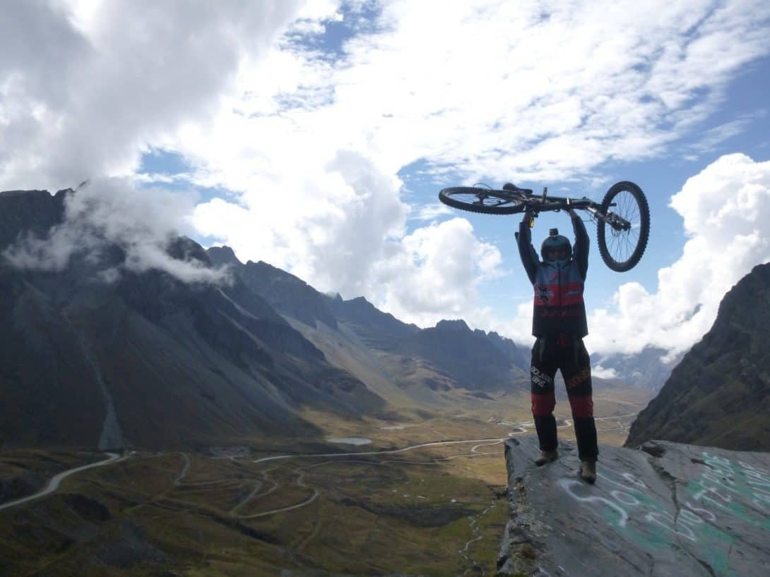 Death Road Cycling Tour - Cyclist holds bike