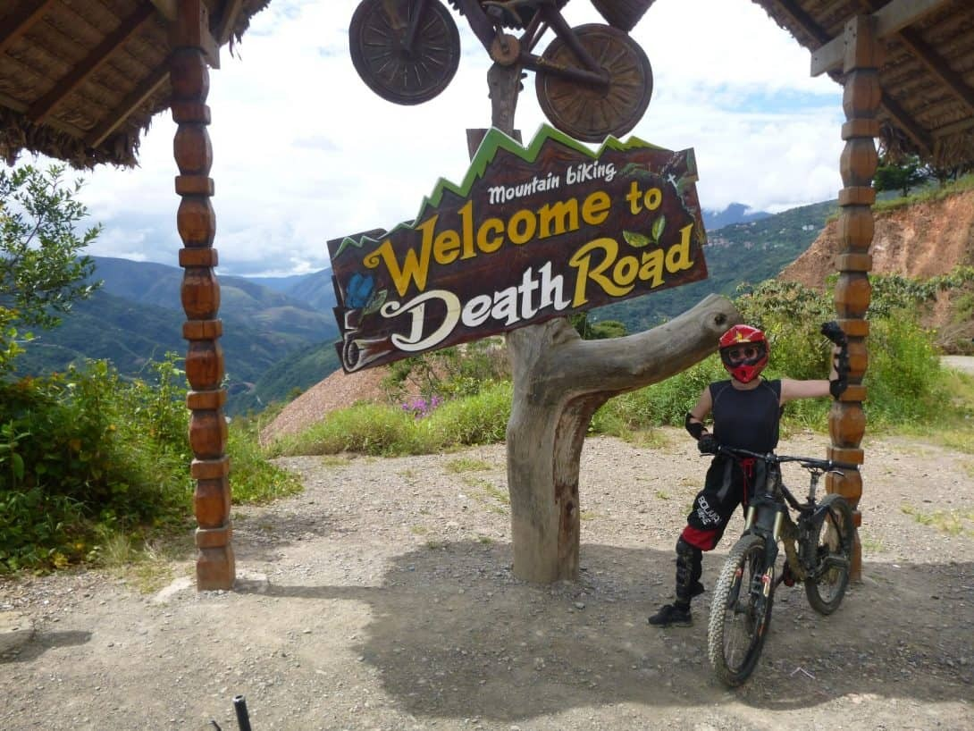 Death Road Cycling Tour - Man and sign