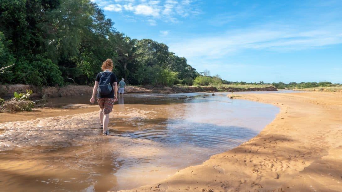 Girl walks through water at Lomas de Arena