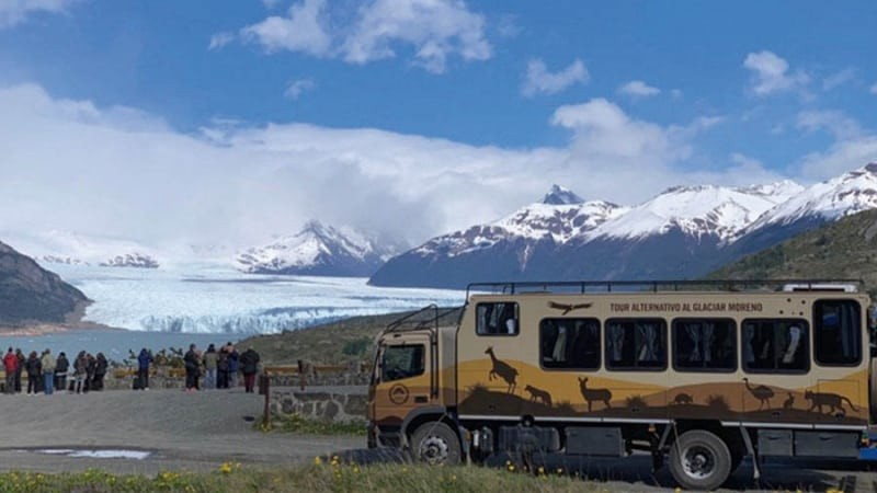 group of tourists looking on the glacier Argentina