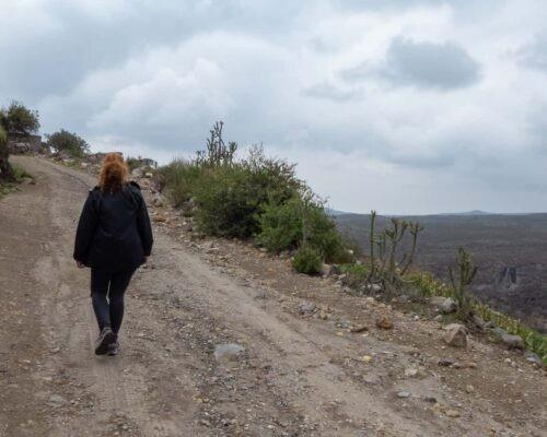 Girl hikes up gravel track