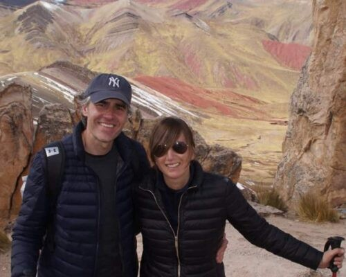 Couple in front of Palcoyo Rainbow Mountain