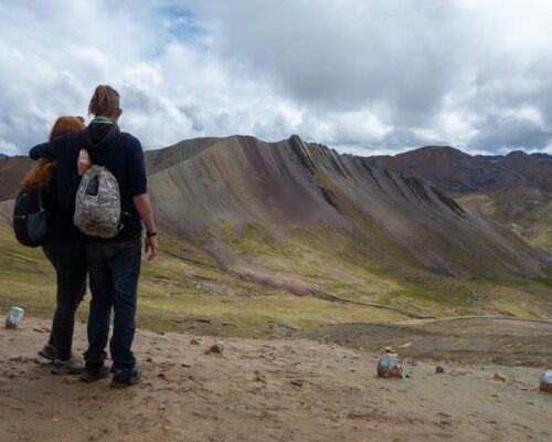 Couple look at Palcoyo Rainbow Mountain