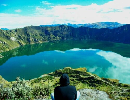 Quilotoa crater lake with person