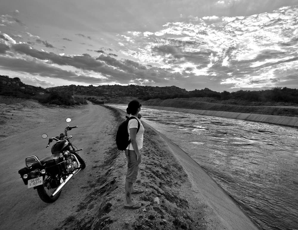 Person with motorcycle in nature