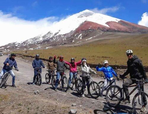 Cyclists near Cotopaxi volcano