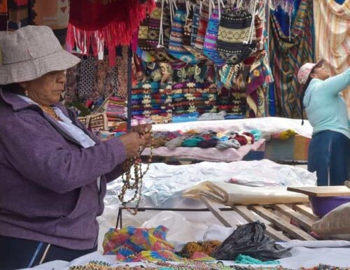 Vendor at Otavalo market.