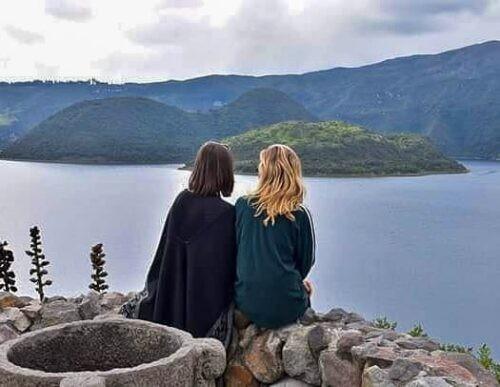 Girls sit at Otavalo Lagoon