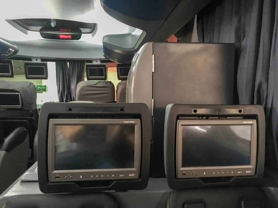 Televisions in night bus, South America.