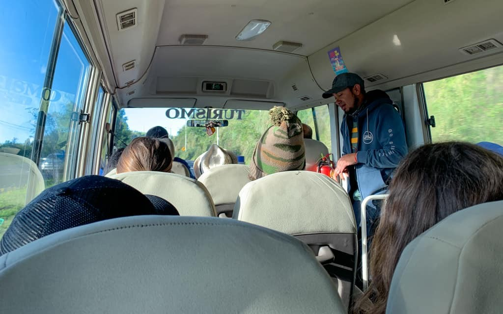 Guide in minibus on way to Cotopaxi.