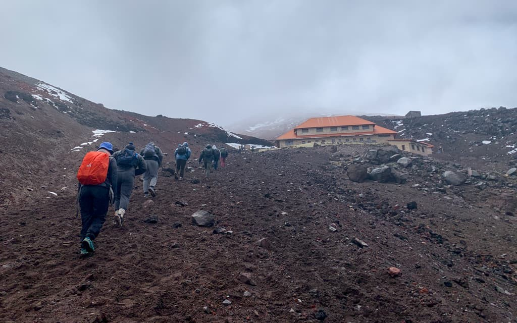 People hiking up to Cotopaxi Refugio.