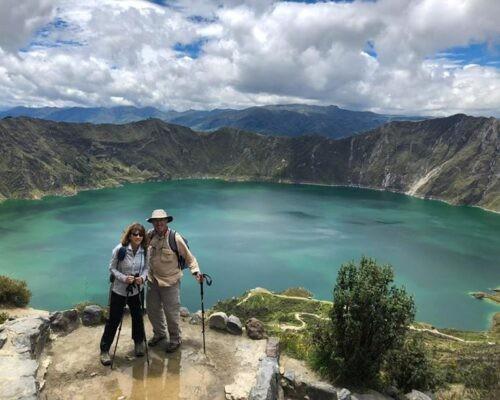 Couple trekking at Quilotoa Crater Lake.
