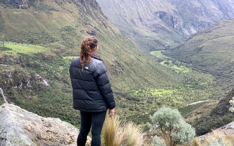 Girl overlooks valley in Peru.