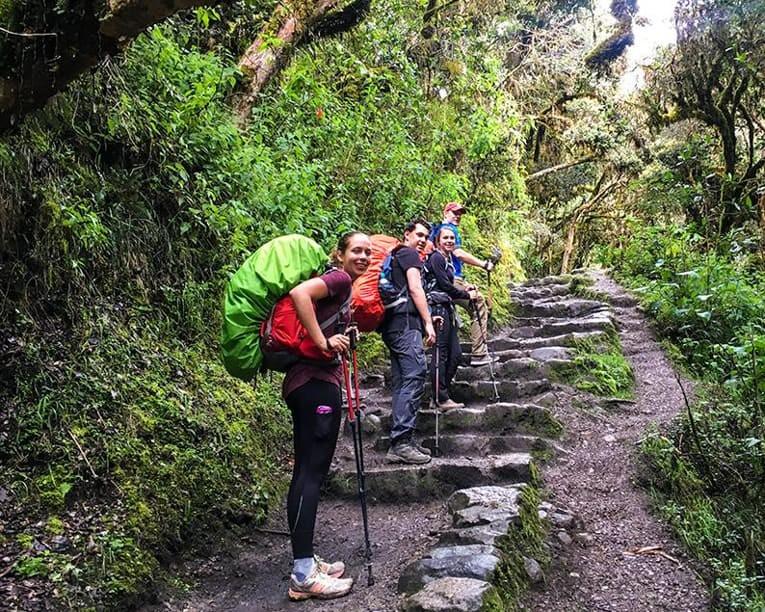Trekkers climb stairs along Inca Trail