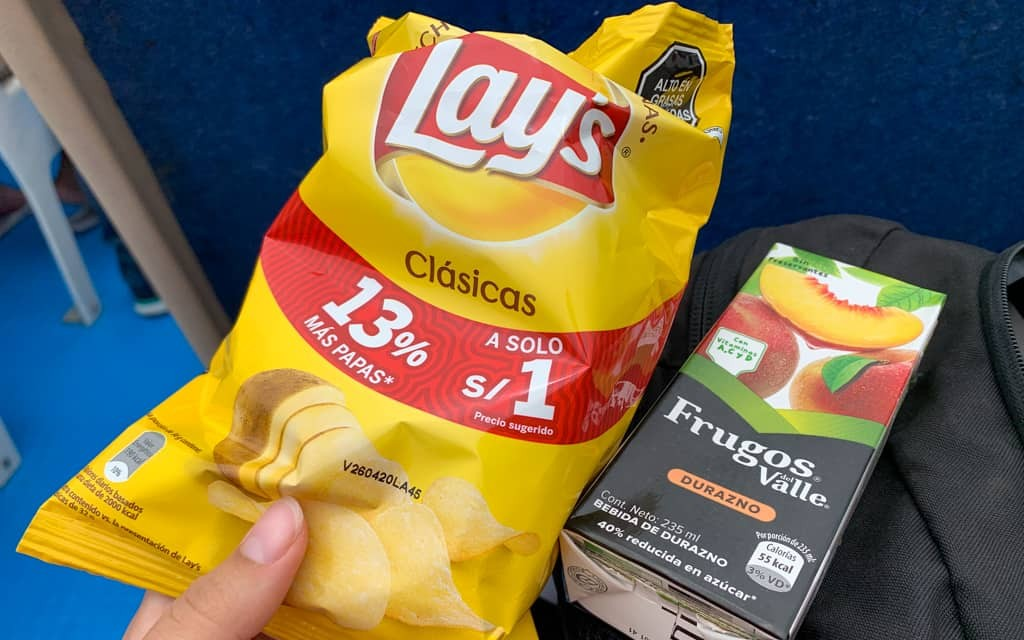 Bag of crisps and juice.