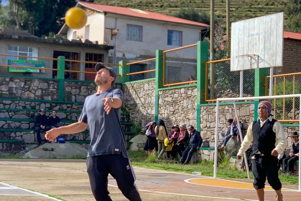 Man plays football in Amantani
