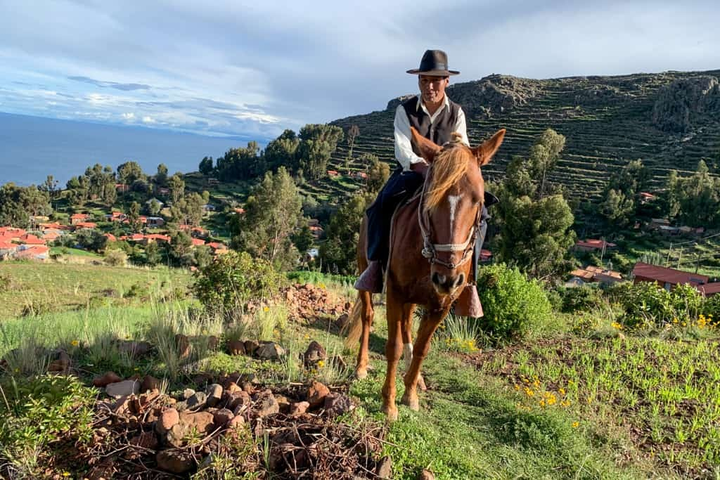 Peruvian man rides horse