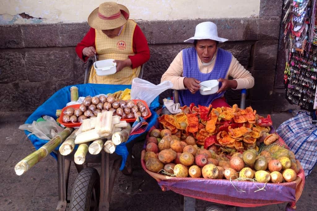 Ladies selling Peruvian fruit